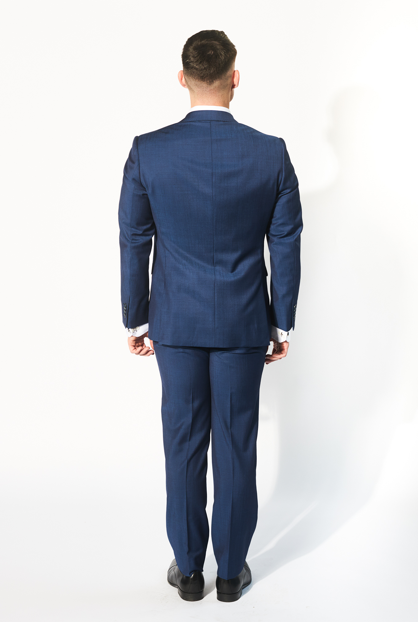 The Marine blue suit side view