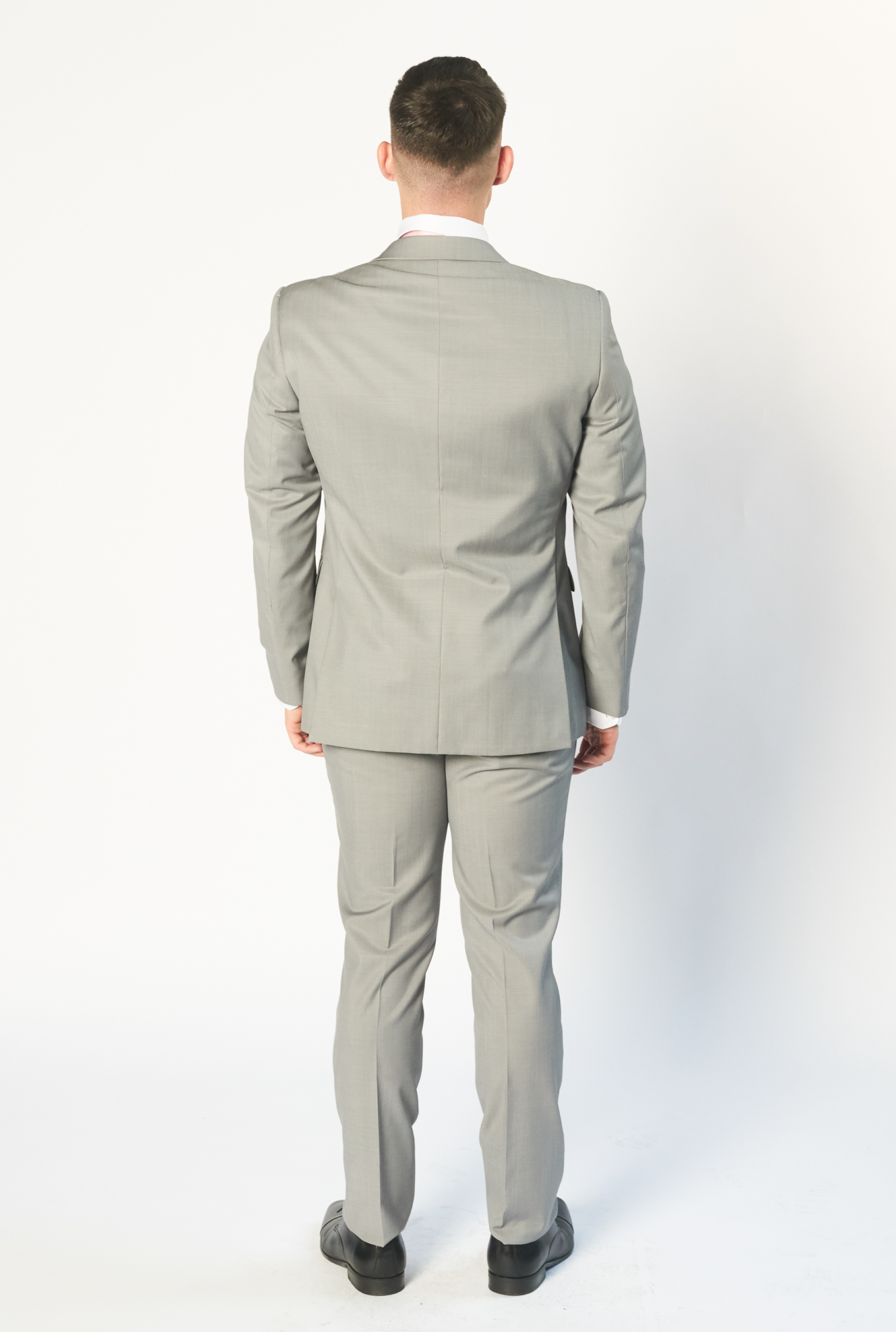 The Jet light grey suit from behind