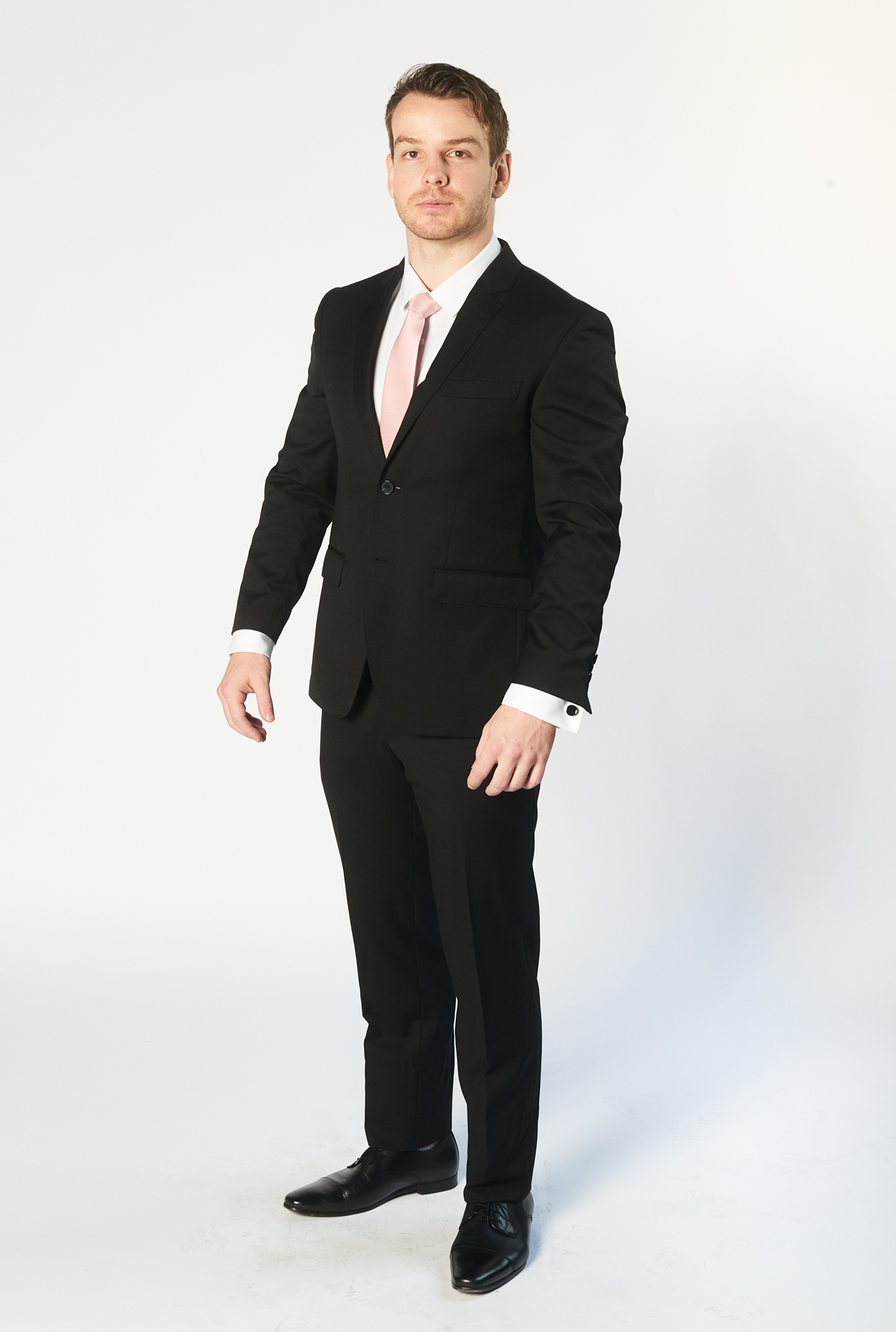 The Cambridge black suit buttoned up