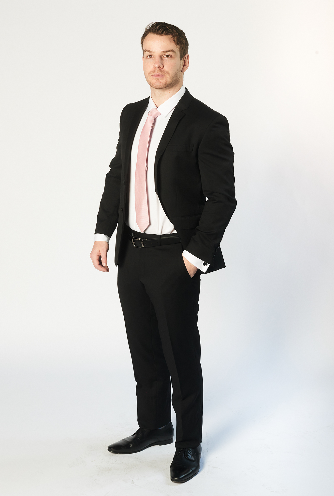 The Cambridge black suit with pink tie