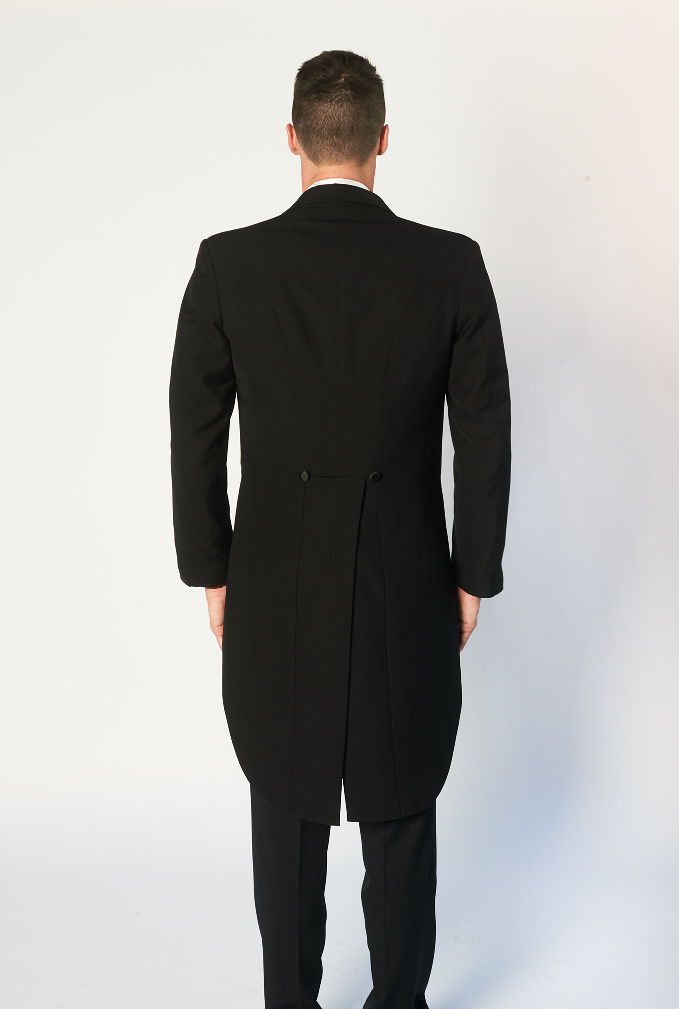 The Tails black suit back view